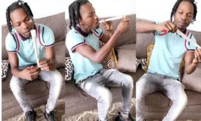 Naira Marley share photos of himself smoking a