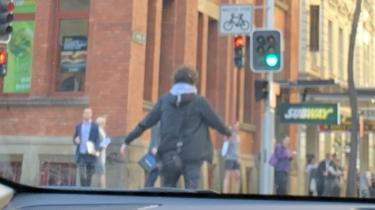 The suspected knifeman standing in the street