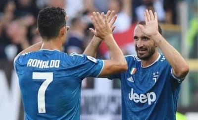 Giorgio Chiellini celebrates scoring with Cristiano Ronaldo