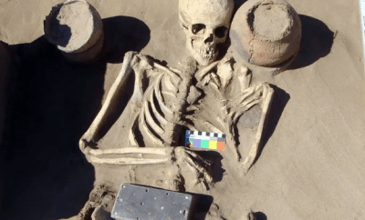 Archaeologists discover ancient skeleton buried with