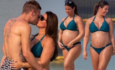 Rebekah Vardy flaunts her blossoming bump as she kisses her husband Jamie Vardy in the sea in Dubai (Photos)