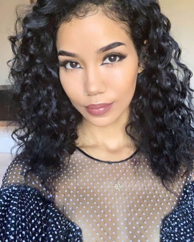 Jhene Aiko flaunts her cleavage and legs in new photos