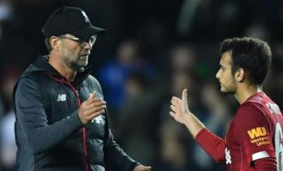 Liverpool manager Jurgen Klopp (left) and midfielder Pedro Chirivella