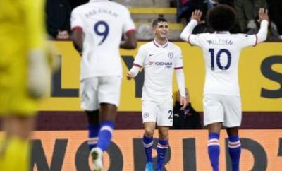 Christian Pulisic celebrates scoring with Willian and Tammy Abraham