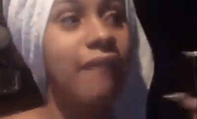 """Cardi B drags follower who called her a """"dumb bitch"""" for saying she identifies as a black woman"""