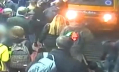 Crowd rescue woman after she fell into the path of an oncoming train (video)