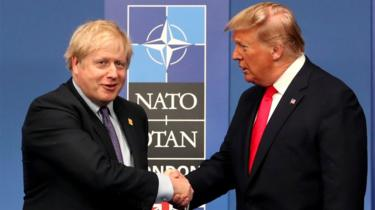 UK Prime Minister Boris Johnson shakes hands with US President Donald Trump during the annual Nato heads of government summit in Watford, England, 4 December 2019