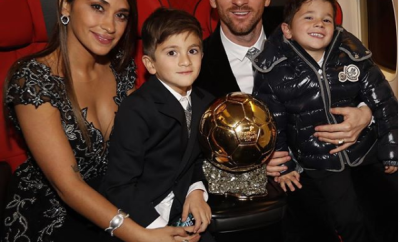Lionel Messi shows off his 6th Ballon d?Or trophy as he poses with his family?(Photo)
