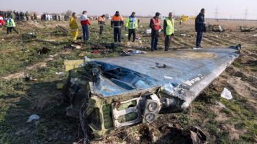 Rescue teams inspect the wreckage of Ukrainian International Airlines flight PS752