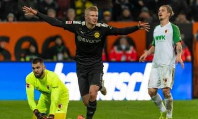 Erling Braut Haaland puts his arms out in celebration after completing his hat-trick on his Borussia Dortmund debut