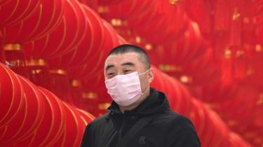 A man in China wearing a mask