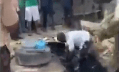 Arrested fruit seller shows law enforcement how he uses gutter water to preserve fruits in Lagos