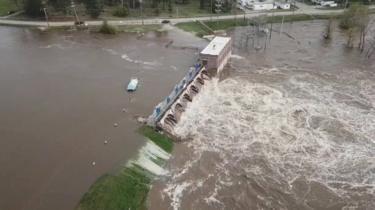 An aerial view of flooding as water overruns Sanford Dam, Michigan