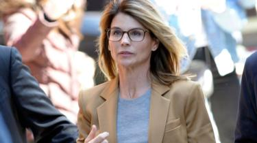 Lori Loughlin arrives to face charges for allegedly conspiring to commit mail fraud and other charges in the college admissions scandal in April 2019