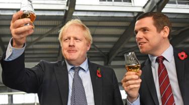Boris Johnson alongside Douglas Ross