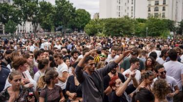 People attending an event for Fete de la Musique in Paris