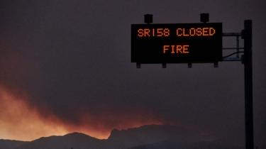 Road sign warns drivers of road closures due to the fire