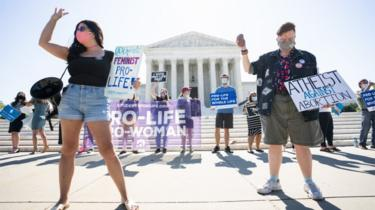 Anti-abortion protesters seen outside the Supreme Court