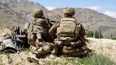 US soldiers look out over hillsides during a visit of the commander of US and NATO forces in Afghanistan on 6 June 2019