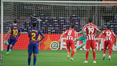 Lionel Messi scores a penalty