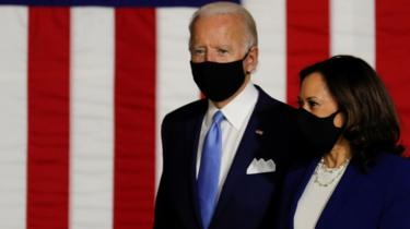 Democratic presidential candidate Joe Biden and vice presidential candidate Senator Kamala Harris take the stage at a campaign event.