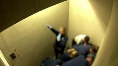A still of video footage from Jozef Chovanec's cell, showing a police officer giving a Nazi salute