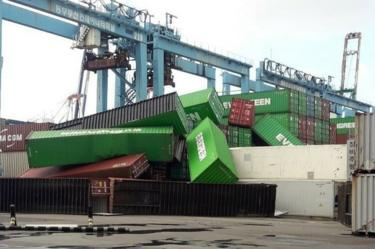 Containers lie in a heap after being blown over by Typhoon Maysak at a pier in Busan, South Jeolla Province, South Korea, 03 September 2020.