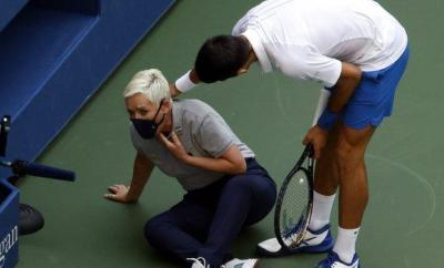 Novak Djokovic checks on the line judge after hitting her with a ball
