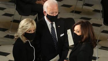 Mr Biden and his wife Jill and running mate Kamala Harris (right)