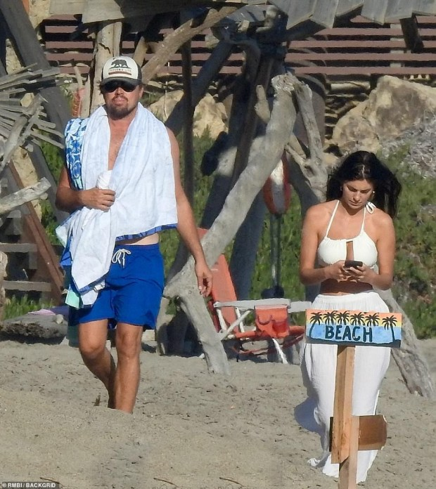 Leonardo DiCaprio, 45, wraps his arms around 23 year old girlfriend, Camila Morrone, while holidaying in Malibu (photos)??