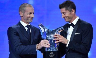 Robert Lewandowski receives the Uefa men's Player of the Year award