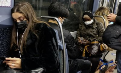 People wearing face masks ride a subway train as second wave of new coronavirus (Covid-19) hits Paris, France on October 27, 2020.
