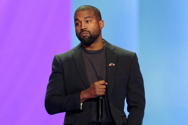Kanye West celebrates as he claims he now has a net worth of billion after falling ? million in debt?