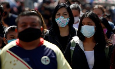 People wear masks in Mexico City