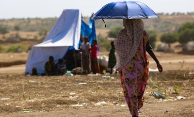 An Ethiopian woman, who fled her home due to ongoing fighting, is pictured at a refugee camp in the Hamdait border area of Sudan's eastern Kassala state on November 12, 2020.