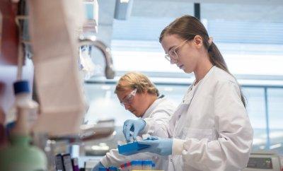 Laboratory scientist / technician handling blood samples from coronavirus vaccine trials inside Oxford University's Jenner Institute on June 25, 2020