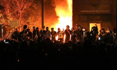 Protesters set fireworks after overrunning the Third Precinct police station in Minneapolis and setting it ablaze (May 2020)