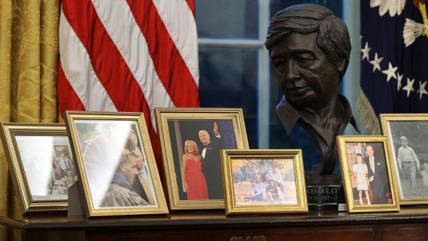 Bust of Cezar Chavez alongside family pictures in Biden's office on 20 January 2021