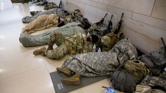 Members of the National Guard rest in the Capitol Visitor Center on Capitol Hill in Washington, DC, USA, 22 January 2021