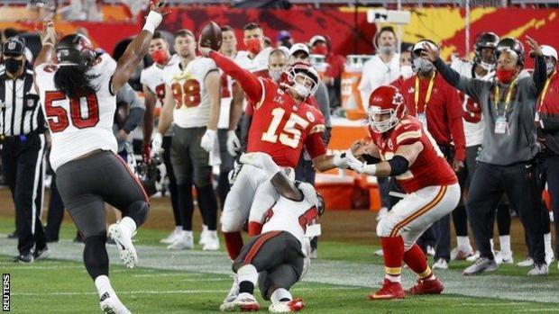 Patrick Mahomes is tackled during Super Bowl 55