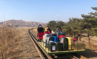 Russian diplomats on hand pushed trolley