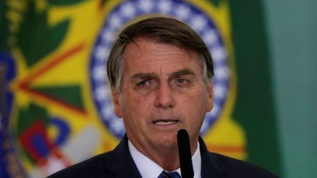 President Jair Bolsonaro speaks during a ceremony to launch a programme to help new mayors, at Planalto Palace in Brasilia, Brazil