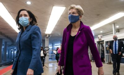 Democratic Senator from Washington Maria Cantwell (L) and Democratic Senator from Massachusetts Elizabeth Warren (R) walk to the Senate chamber as the Senate meets, 5 March