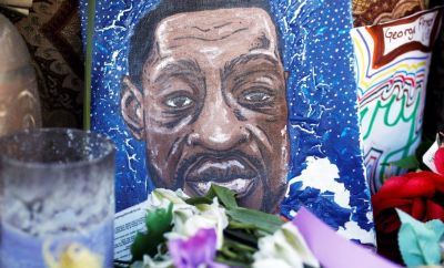 A small painting in memory of George Floyd is seen next to Cup Foods at George Floyd Square while the city of Minneapolis enters its third day of the trial of Derek Chauvin, who is facing murder charges in the death of George Floyd, in Minneapolis, Minnesota, U.S., March 31, 2021.