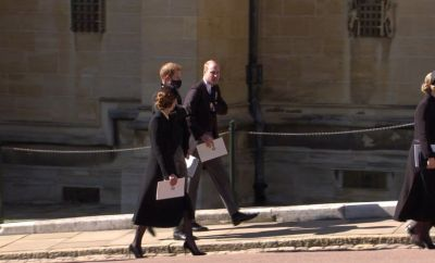 The Duke and Duchess of Cambridge and the Duke of Sussex chatting after the service