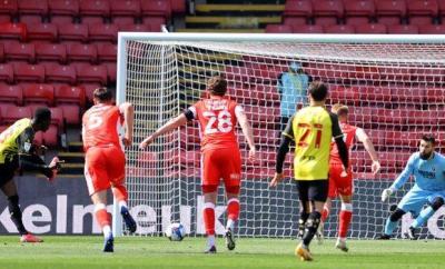 Ismaila Sarr (far left) scores a penalty for Watford