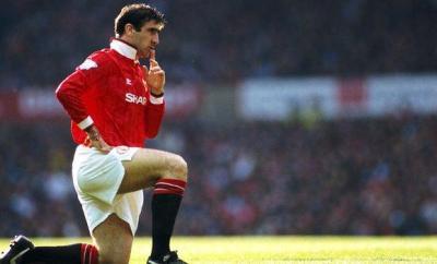 Eric Cantona celebrates scoring for Manchester United
