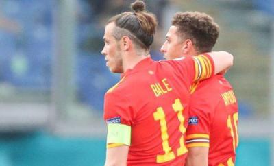 Gareth Bale escorts Ethan Ampadu off the field