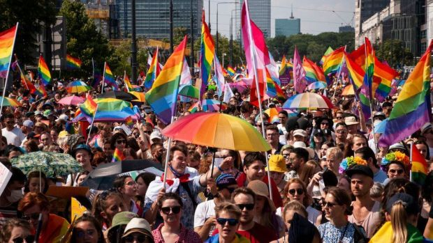 Crowd with LGBT rainbow flags in Warsaw
