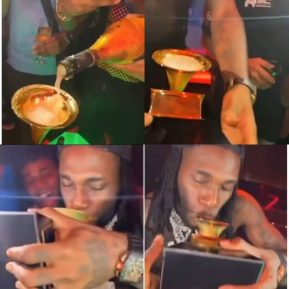 Burna Boy takes his Grammy plaque to the club, uses it to drink champagne (video)